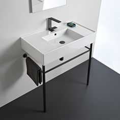 This 32 inch console set was designed by Italian manufacturer Scarabeo. Inspired by the modern or contemporary style bathroom, this console comes with a white ceramic sink and matte black console mount. This console is available in one hole, three hole, or no hole settings. It is part of the Teorema 2.0 collection.