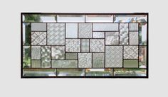 This stained glass panel is a sampling of textures of clear glass in a geometric abstract pattern. The panel is approximately 22 1/2 x 11 1/2.  The outside border is clear beveled pieces.  The panel can be hung in either vertical or horizontal direction. The patina on the solder is black and the zinc frame is left in the silver tone. To see more abstract geometric panels http://www.etsy.com/shop/sghovel?section_id=10763111  To see all of my items sghovel.etsy.com/  Shipping is either via…