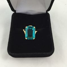 Beautiful gold ring Teal colored stone in gold setting. Marked Jewelry Rings