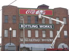 vintage Coca-Cola sign being re-lettered on old bottling plant in Lynchburg, Virginia by Retronaut, via Flickr