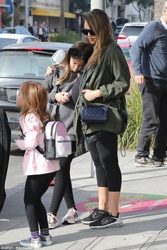 Awww! Jessica Alba, 36, cradled her nine-year-old daughter Honor after the family grabbed ...