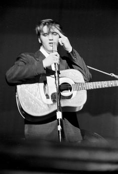 Elvis Chats With HisAudience by Alfred Wertheimer |     Elvis during the second performance of the Elvis Presley Show at the Mosque Theatre, Richmond VA. sings and chats with his audience which is 90% teenage girls. June 30, 1956.