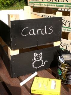 Old crates with chalkboard paint on ends for storage.