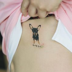 Pinscher tattoo on the left ribcage. Tattoo artist: Sol Tattoo