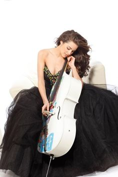 Olivia Culpo, cellist and Miss USA 2012, supports arts education.