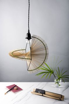 """Pendant light from the 2016 """"Riyar"""" collection by Kamaro'an. Design by Yun Fann and Shane Liu. Photo by Jy Yuan."""