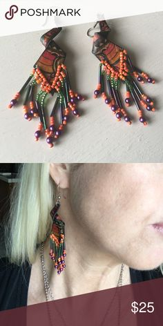 Hand dyed colorful leather earrings 🎉Vibrant multicolored dangling earrings in hand dyed leather. Orange + green + purple. Ethnic vibes. Purchased in Veracruz, Mexico. These are fun & festive for Halloween, Mardi Gras or whenever you need a little pick me up! 🎉Make an offer or bundle up! As always, I will create a custom bundle when buying 3+ for the best discount! Just ask! 🐺😘💗 Jewelry Earrings