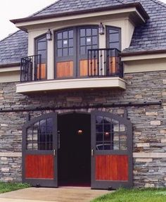 Love the stone facade and the wood in the doors. Barn doors by Lucas Equine. Do a guest house over the garage and a man cave under it. Have the garage designed so it can become an additional guest space for entertaining. - http://www.homedecoz.com/home-decor/love-the-stone-facade-and-the-wood-in-the-doors-barn-doors-by-lucas-equine-do-a-guest-house-over-the-garage-and-a-man-cave-under-it-have-the-garage-designed-so-it-can-become-an-additional-guest-spa/