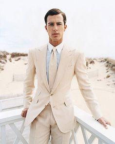 Shop this look on Lookastic: https://lookastic.com/men/looks/beige-suit-light-blue-dress-shirt-beige-tie/10642   — Light Blue Dress Shirt  — Beige Tie  — Beige Suit