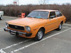 Toyota Corolla SE Liftback, mine was a little different color but was closer to orange than red.