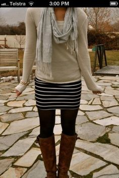 Travel clothes. Striped skirt, black tights, brown boots, beige oatmeal neutral shirt, neutral scarf
