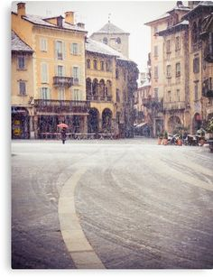 Atmospheric shot of an old Italian square with medieval houses on a snowy day bySilvia Ganora / Lumix lx7 / Shot in my hometown in Northern Italy • Also buy this artwork on wall #prints, #stickers, #phonecases. #wallart #italy #snow