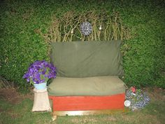 My garden bench made from Pallets that I got off of Freecycle. For the cushioning, I used the padding from an old sofa that we no longer needed.  The base is a storage box.