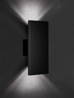 Box sconce in carbon fiber. Designed by ONO for Vistosi