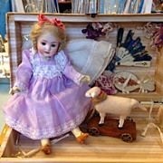 """Antique 8,25"""" German doll in trunk with extras"""