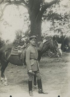 Otto Frank with a horse. On the back of the photograph is written: 'Otto September 1918'.
