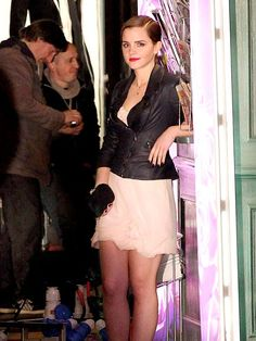 THINK PINK  A gussied-up Emma Watson looks like she's worlds away from Hogwarts as she films her first commercial in Paris as the new face of Lancôme on Monday.