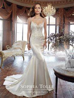 "Sophia Tolli - Y21510 – Bobbi - Lustrous satin fit and flare wedding dress, hand-beaded scooped neckline and shoulder straps, bodice with lace appliqués and plunging illusion back neckline, back zipper trimmed with diamante buttons and a chapel length train. Also available with a 3"" raised back neckline as Y21510HB.  Sizes: 0 – 28  Colors: Ivory, White"