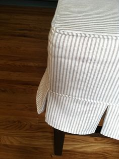 ticking stripe slipcover w/ box pleat detail . Slipcovers For Chairs, Dining Chairs, Ottoman Slipcover, Home Decor Furniture, Furniture Makeover, Furniture Upholstery, Slip Skirts, Ticking Stripe, Textiles