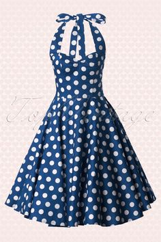 This gorgeous 1950s style halter Mariam Swing Dress in Polka navy…