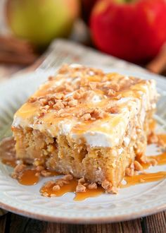 Caramel Apple Pie Poke Cake Recipe - apple cake soaked in caramel sauce topped with cool whip and toffee bits - AMAZING! Can make ahead of time and refrigerate. It gets better as it sits in the fridge. Super delicious cake!