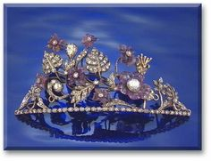 AMETHYST AND DIAMOND TIARA/BROOCH Designed as a floral spray of rose-cut diamond leaves and buds interspersed with carved amethyst flowers, central section detaches to be worn as a brooch.
