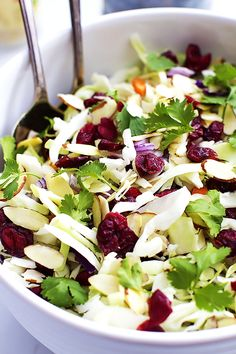 Crunchy Asian chopped salad with tangy dried cranberries, sliced almonds, cilantro, and the best 2-minute homemade sesame dressing! | Creme de la Crumb