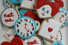 Love the alice in wonderland theme clock, eat me and Ace card cookies - so neat.