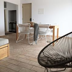 Hege in France Nordic meets Portuguese style living room white ikea chairs handmade tiled floor