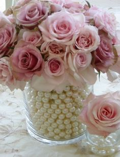 Lovely Centerpiece Idea~ Fill a smaller vase with water and insert your fresh flowers. Then place it in the center of a larger vase and fill in fake pearls around to conceal the smaller vase. This is a great idea for a bridal shower, wedding or anniversary. Wanna try this with pearls, shells, & some bling all mixed together for my renewal vows reception!
