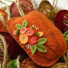 I finished a whole lot of these pumpkins. This batch is for the quilt show that I will be selling at at the end of September. Any left aft. Fall Felt Crafts, Felted Wool Crafts, Autumn Crafts, Wool Applique Patterns, Felt Patterns, Felt Applique, Fabric Crafts, Sewing Crafts, The Quilt Show