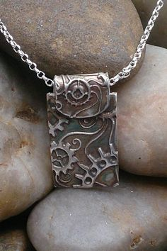Handcrafted sterling silver steampunk tag necklace.