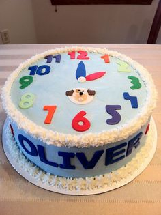 Toddler Clock Birthday Cake - Buttercream iced clock cake with fondant decorations for a 2 yr old's birthday.  He is obsessed with numbers and clocks and loves dogs.