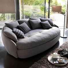 contemporary sofa with round shapes and soft upholstery fabric