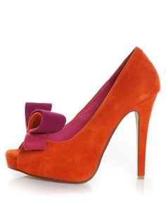 orange suede with asymmetrical magenta bow...