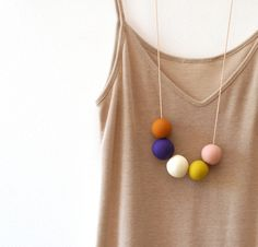 not quite round handmade beads make a necklace