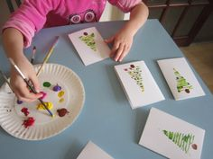 These are our first Christmas Cards. To make them we pulled the top layeroff a piece ofcardboard, cut out some triangle shapes and after putting on some green paint, we printed some small Christm…