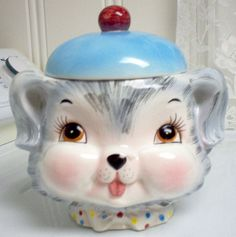 "ESD/Lefton/Enterprise Exclusive Miss Priss Puppy Pal Cookie Jar  Contrary to what many people believe, ESD (Enterprise Sales and Distributors) is not ""Canadian Lefton"". ESD was a company in Canada whose owner, Harry Pearl, travelled to Japan with George Lefton. While in Japan, both men purchased a lot of the same items for their companies; one exclusively in Canada and the other exclusively in the US. This is why both the Lefton and ESD labels are found on some identical pieces."