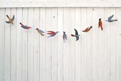 We're always on the lookout for sweet party decorations that are as unusual and affordable as they are easy to put up and take down. This illustrated bird garland kit by New York artist Kaye Blegvad does the trick.