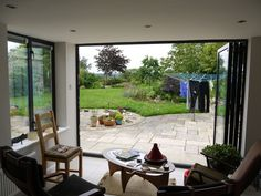 Bringing the outdoors in! Bifold Doors opening up into the garden.