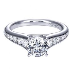 14k white gold 1.50cttw graduated channel set round diamond engagement ring with 1ct center. A twist on a timeless classic, this clean and classic channel set engagement ring features round G/SI diamo