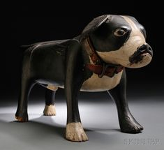 Rare Painted Wood Carving of a Boston Bull Terrier, by Augustus (Gus) Wilson (1864-1950), South Portland, Maine, 1930-35, fully carved standing figure constructed of several joined wood segments, painted with black, white, and red paint, with original brass studded red leather collar, ht. 12, wd. 8 3/4, lg. 25 in.