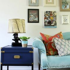 Tour a vintage eclectic living room decorate with budget friendly pieces.