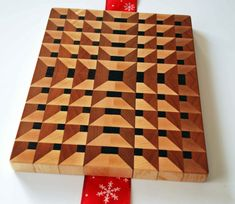 Brand new and Unique 3D Pigeon-Hole End Grain Butcher Block Cutting Board. Unavailable anywhere else. This 3D design works really well. The boards thickness lends to the visual depth of the cubby-holes. Perfect for slicing meats, breads, vegetables, cheeses, etc. Be the first to own one! End grain boards are made by cutting lumber into blocks and gluing them together with the end grain up to form the cutting surface. The woods end grain is easy on knives. If you are buying for a serious…