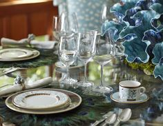 Peacock feather place mats fit with the dining room's blue-and-green scheme. China is designed by Marchesa from Lenox - Traditional Home® / Photo: John Merkl / Design: @Julia Buckingham Edelmann