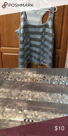 Razor Back Silver Sequin Tank This is a beautiful silver sequin tank.  It is in perfect condition. Tops Tank Tops