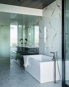 The Bianca freestanding bath is the focal point of this stunning master bathroom designed by Mark Nichols Modern Interiors Inc. (photography by Lance Gerber)  #jacuzziluxurybath #freestandingbath #bianca #masterbath #bathroom #interiordesigner #interiordesign #bathroomgoals #luxebathroom #interiorandhome #interior_design #interiordesigns #bathroomdesign
