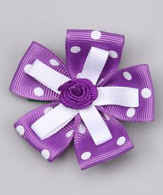Just a little heads-up: this grosgrain ribbon clip is just about the prettiest thing ever. It features a non-pinching fastener and plenty of attention to detail.
