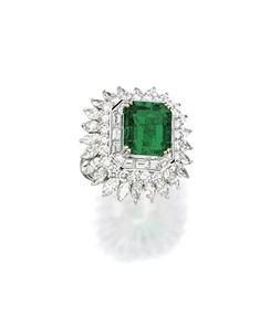EMERALD AND DIAMOND RING. Centring on an octagonal step-cut emerald weighing 9.50 carats, to a tiered triple border of baguette, brilliant-cut and pear-shaped diamonds together weighing 7.00 carats, mounted in 18 karat white gold.