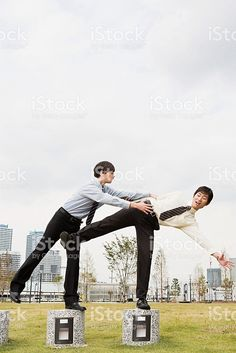 Businessman helping colleague royalty-free stock photo